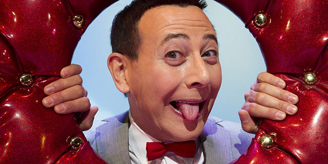 "In this Friday, Oct. 29, 2010 photo, Paul Reubens, in character as Pee-wee Herman, poses on stage after a performance of ""The Pee-wee Herman Show"" on Broadway in New York. (AP Photo/Charles Sykes)"